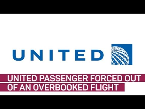 Phone video shows United passenger being pulled off plane (CNET News)