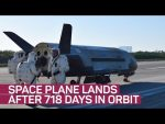 Secretive space plane lands after 718 days circling Earth (CNET News)