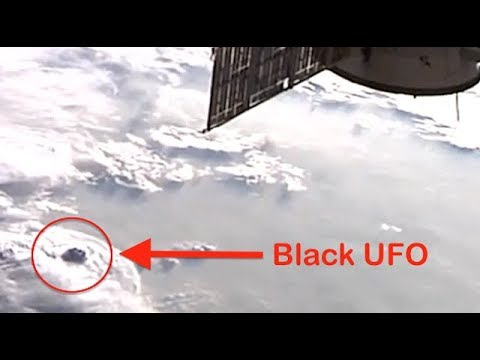 Black UFO Hides Over Clouds Caught By NASA Space Station Cam