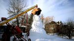 See How This Canadian Family Builds Their 20-Foot-Tall Snowman