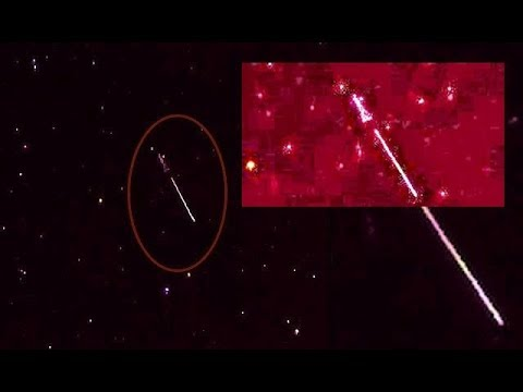 Giant Beam of Light appears to shoot from Triangular Shaped Space Object