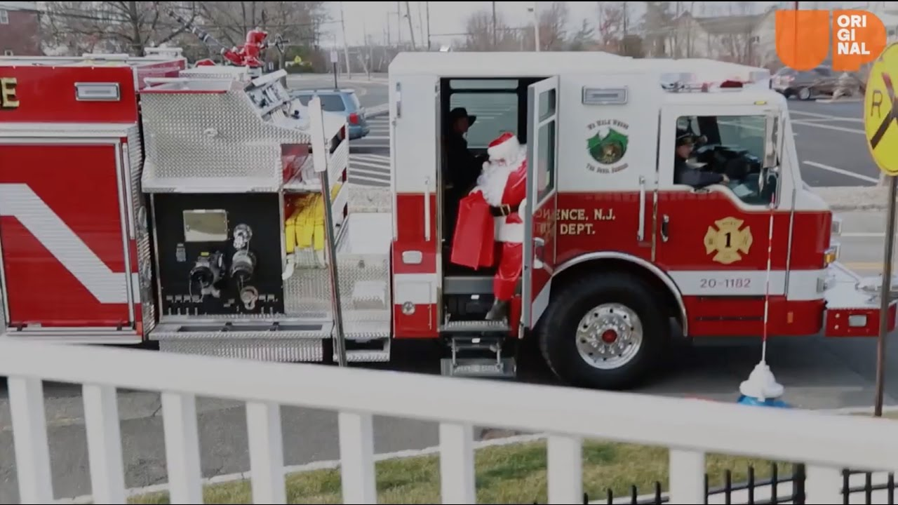 In this town, Santa delivers presents from a fire truck.