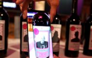 Wine labels transform into talking T-Mobile executives — in this case, T-Mobile technology officer Neville Ray — when an app is scanned over them at the Tech Experience lab.  (Greg Gilbert/The Seattle Times)