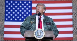 Speaking to troops, Trump gets overtly political, talking border wall and leaving Syria