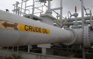 Oil eases on U.S. stocks build despite trade talk hopes